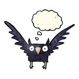 Cartoon spooky bird with thought bubble Stock Photo