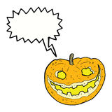 Cartoon spooky pumpkin with speech bubble Stock Images