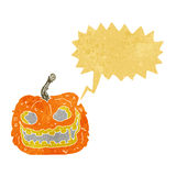 Cartoon spooky pumpkin with speech bubble Royalty Free Stock Images