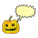 Cartoon spooky pumpkin with speech bubble Royalty Free Stock Photos