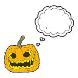 Cartoon spooky pumpkin with thought bubble Stock Images