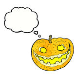Cartoon spooky pumpkin with thought bubble Royalty Free Stock Image