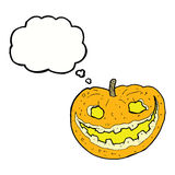 Cartoon spooky pumpkin with thought bubble Royalty Free Stock Photos