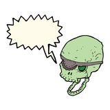 Cartoon spooky skull with eye patch with speech bubble Stock Photos