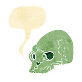 Cartoon spooky skull with speech bubble Stock Image