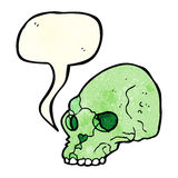 Cartoon spooky skull with speech bubble Stock Images