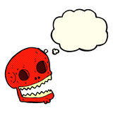 Cartoon spooky skull with thought bubble Stock Images