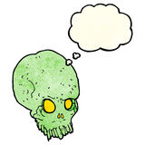 Cartoon spooky skull with thought bubble Royalty Free Stock Photography