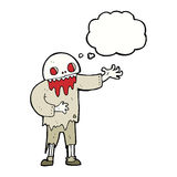 Cartoon spooky zombie with thought bubble Stock Images
