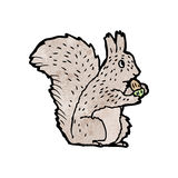 Cartoon squirrel nibbling nut Stock Photos
