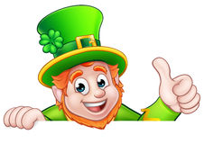 Cartoon St Patricks Day Leprechaun Top of Sign. Cartoon Leprechaun St Patricks Day character peeking over a sign and giving a thumbs up Stock Photos