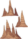 Cartoon stalagmites. Vector clip art illustration with simple gradients. Each group on a separate layer Royalty Free Stock Image