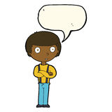 Cartoon staring boy with folded arms with speech bubble Stock Image