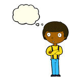 Cartoon staring boy with folded arms with thought bubble Stock Photo