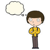 Cartoon staring boy with folded arms with thought bubble Stock Image