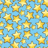 Cartoon stars against blue background. Seamless Royalty Free Stock Image