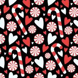 Cartoon style black candy cane and peppermint twist with hearts seamless seasonal Christmas graphic illustration pattern stock illustration