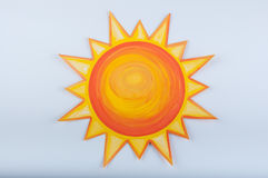 Cartoon sun drawn with gouache on white background Stock Photos
