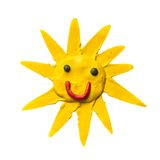 Cartoon sun with smile. Made of plastiline Royalty Free Stock Photography