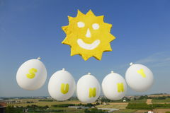 A cartoon sunny in the sky Royalty Free Stock Images