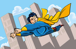 Cartoon superman flying. With his cape billowing behind. A cityscape behind him Royalty Free Stock Photo
