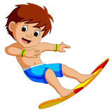 Cartoon surfer boy Royalty Free Stock Images