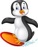 Cartoon surfing penguin Royalty Free Stock Photography
