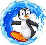 Cartoon surfing penguin Royalty Free Stock Image