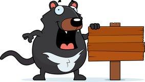 Cartoon Tasmanian Devil Sign. A cartoon Tasmanian devil with a wooden sign Royalty Free Stock Image