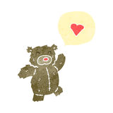 Cartoon teddy bear with love heart Royalty Free Stock Photo