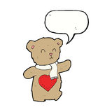 Cartoon teddy bear with love heart with speech bubble Royalty Free Stock Image