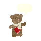 Cartoon teddy bear with love heart with speech bubble Stock Image