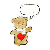 Cartoon teddy bear with love heart with speech bubble Royalty Free Stock Photo