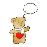 Cartoon teddy bear with love heart with thought bubble Royalty Free Stock Images