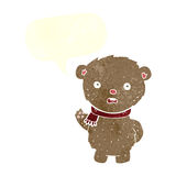 Cartoon teddy bear wearing scarf with speech bubble Stock Images