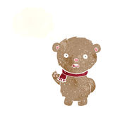Cartoon teddy bear wearing scarf with thought bubble Royalty Free Stock Photo