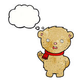 Cartoon teddy bear wearing scarf with thought bubble Stock Photography