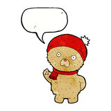 Cartoon teddy bear in winter hat and scarf with speech bubble Royalty Free Stock Image