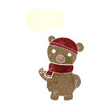 Cartoon teddy bear in winter hat and scarf with speech bubble Royalty Free Stock Photography