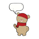 Cartoon teddy bear in winter hat and scarf with speech bubble Royalty Free Stock Photo