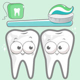 Cartoon teeth with toothbrush and dental floss Stock Photo
