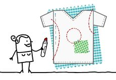 Cartoon Textile Designer Drawing a Tee Shirt. Vector Cartoon Textile Designer Drawing a Tee Shirt Royalty Free Stock Photography