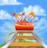 Cartoon Theme Park Roller Coaster. Cartoon happy boy and girl children riding on a roller coaster ride at a theme park or amusement park Royalty Free Stock Images
