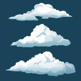 Cartoon three blue sky clouds Stock Photos