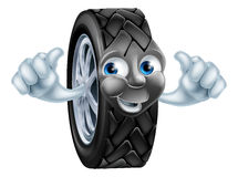 Cartoon tire mascot. An illustration of a cartoon tire (tyre) character or mascot giving a thumbs up Stock Image