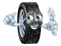 Cartoon tire mascot with wrench Stock Photos