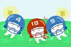 Cartoon tooth american football players. On the grass Royalty Free Stock Image