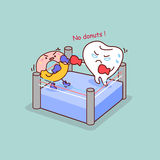 Cartoon tooth boxing with donut Royalty Free Stock Photo