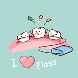 Cartoon tooth with dental floss Royalty Free Stock Images