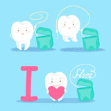 Cartoon tooth with floss Stock Photo